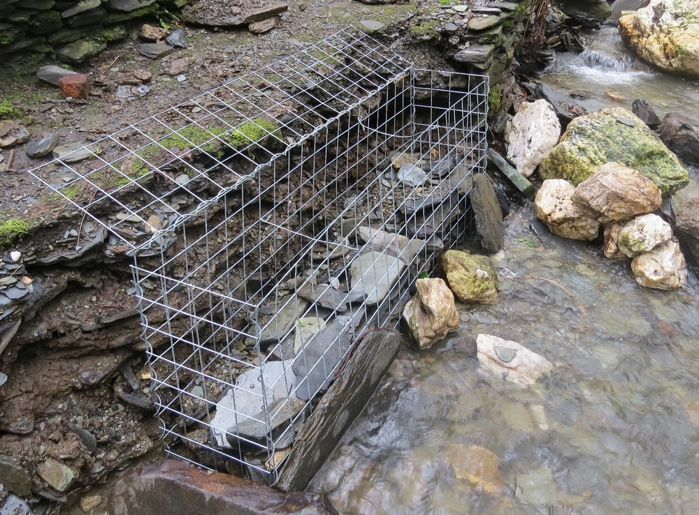 gabion damaged river bank