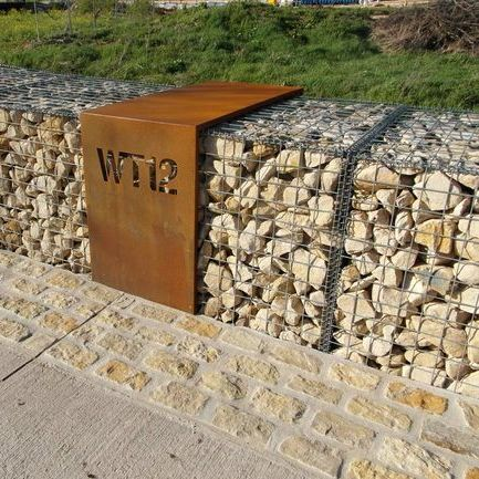 gabion wall with modern house number